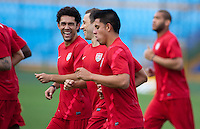 (Left to right) Herculez Gomez, Steve Cherundolo and Joe Corona warm up before practice at Estadio Mateo Flores in Guatemala City, Guatemala on Mon. June 11, 2012.  The USA will face Guatemala in a World Cup Qualifier on Tuesday.
