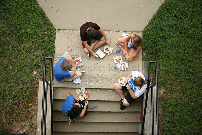 Students enjoy free food during We Are UK near the Funkhouser Building in Lexington, Ky., on Tuesday, August 27, 2013. Photo by Adam Pennavaria   Staff
