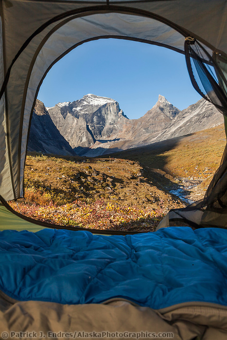 Xanadu and Arial peaks as viewed from inside a tent in the Arrigetch Peaks, Gates of  the Arctic National Park, Alaska.