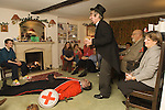 Quack Doctor about to revive St George and bring him back to life. The Bampton Mummers performing Christmas Eve. Bampton Oxfordshire.   UK 2008.