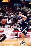January 26, 2002:  Illinois State Redbirds basketball player Shedrick Ford defended by Andry Sola...This image was scanned from a print.  Image quality may vary.  Dust and other unwanted artifacts may exist.
