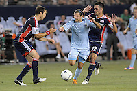 Graham Zusi (8) midfield Sporting KC attacks the Revolutiobn goal..Sporting Kansas City and New England Revolution played to a 0-0 tie at LIVESTRONG Sporting Park, Kansas City, KS.