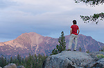 Woman watching alpenglow on Highland Peak, Toiyabe National Forest, California