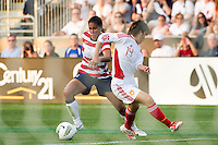 Shannon Boxx (7) of the United States (USA) gets past Liu Shukun (14) of China (CHN). The United States (USA) women defeated China PR (CHN) 4-1 during an international friendly at PPL Park in Chester, PA, on May 27, 2012.