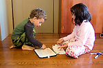Berkeley CA Brother, four-years-old, getting a lesson in writing from sister, six MR