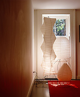 A collection of Noguchi paper lamps grouped in the living room window of a New York town house