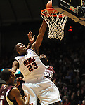 Mississippi's Reginald Buckner (23) dunks over Mississippi State's Arnett Moultrie (23) at the C.M. &quot;Tad&quot; Smith Coliseum in Oxford, Miss. on Wednesday, January 18, 2012. (AP Photo/Oxford Eagle, Bruce Newman).