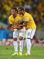 Neymar of Brazil helps an injured Thiago Silva to his feet