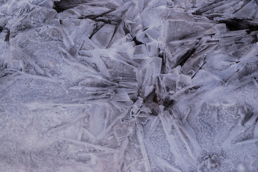 Patterns in the frozen creek great geometric abstracts on a chilly morning.