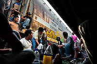 "Central American immigrants, sitting under the stopped cargo train, wait to climb it up again when it departs to cross the state of Chiapas in the south of Mexico, on 25 May 2010. Between 2010 and 2015, the US and Mexico have apprehended almost 1 million illegal immigrants from El Salvador, Honduras, and Guatemala. While the economic reasons remain the most frequent motivation for people from Central America to illegally immigrate to the US, thousands of Salvadorans, Guatemalans, and Hondurans, many of them minors, seek asylum in the US due to the thriving crime and gang-related violence in their region (known as the Northern Triangle). Taking an exhausting and risky journey, riding thousands of miles atop the cargo trains, facing a physical danger and extortion from the organized crime groups that control migrant routes, the ""undocumented"" still flee to the US, looking for their American dream."