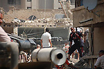 BAGHDAD, IRAQ: Men sort through the rubble after a bomb explosion in the Alawi neighborhood, a Shia area in Baghdad...Bombs destroyed seven buildings in three areas of the Iraqi capital Baghdad, killing at least 28 people and wounding 75.