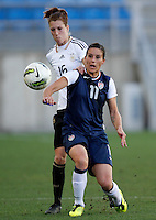USA's Ali Krieger fights for the ball with Germany's Verena Faibt during their Algarve Women's Cup soccer match at Algarve stadium in Faro, March 13, 2013.  .