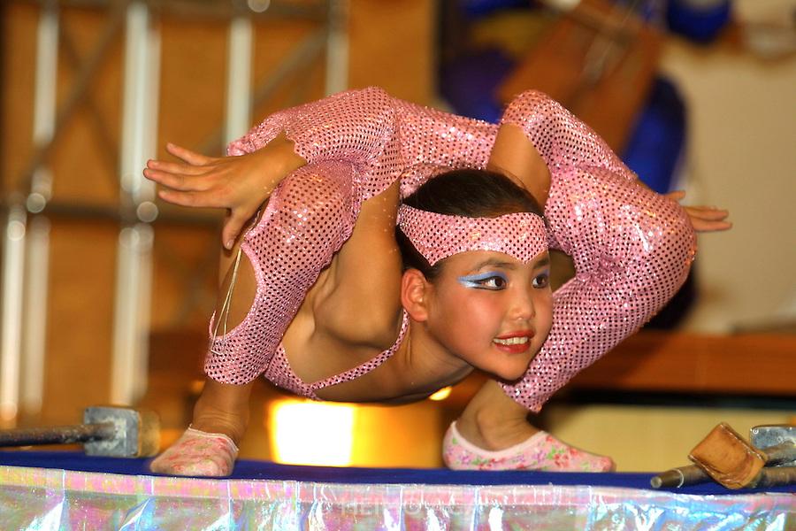 ULAN BATOR, MONGOLIA..08/22/2001.Folcloric show at Bayangol Hotel. Young contortionist girl..(Photo by Heimo Aga)
