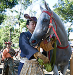 A horseback archer guides his steed along the course during the annual Reitaisai Grand Festival at Tsurugaoka Hachimangu Shrine in Kamakura, Japan on  14 Sept. 2012.  Sept 14 marks the first day of the 3-day Reitaisai festival, which starts early in the morning when shrine priests and officials perform a purification ritual in the ocean during a rite known as hamaorisai and limaxes with a display of yabusame horseback archery. Photographer: Robert Gilhooly
