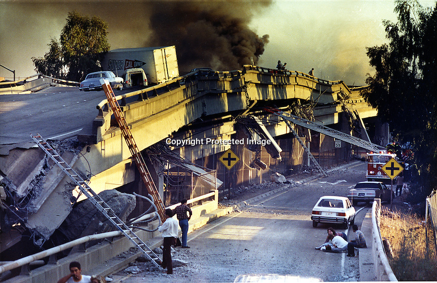 Oakland, Ca,  Oct 17,1989 The double-deck Cypress freeway is collapsed during the Loma Prieta earthquake. (photo/Paul Scott, Oakland Tribune)