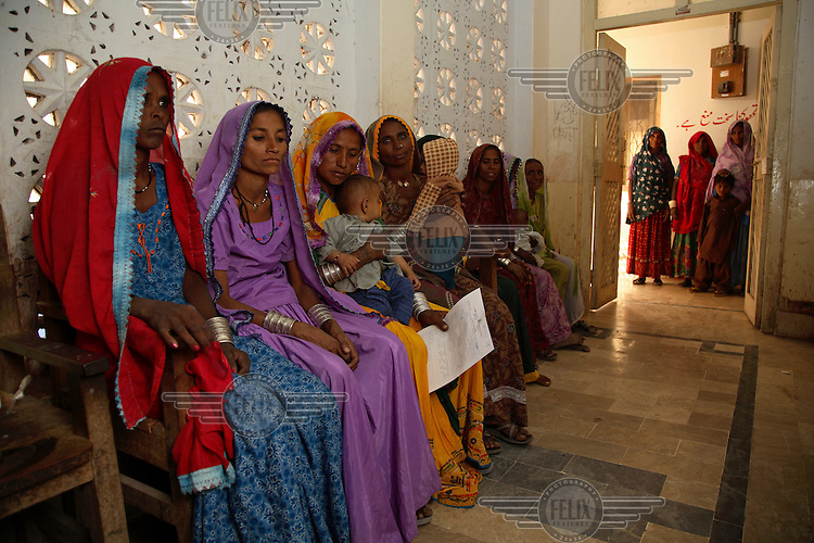 Women await their turn at the Meerwah Gorchani sub-district hospital for tubular ligation surgery, a procedure performed periodically by a visiting specialist surgeon. .