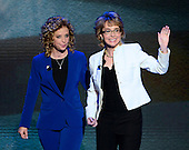 United States Representative Debbie Wasserman Schultz (Democrat of Florida), Chairman of the Democratic National Committee, escorts former U.S. Representative Gabby Giffords (Democrat of Arizona), to the podium to lead the Pledge of Allegiance to the Flag at the 2012 Democratic National Convention in Charlotte, North Carolina on Thursday, September 6, 2012.  .Credit: Ron Sachs / CNP.(RESTRICTION: NO New York or New Jersey Newspapers or newspapers within a 75 mile radius of New York City)