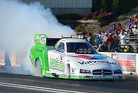 May 18, 2012; Topeka, KS, USA: NHRA funny car driver Jack Beckman during qualifying for the Summer Nationals at Heartland Park Topeka. Mandatory Credit: Mark J. Rebilas-