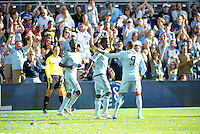 Sporting KC players celebrate C.J Sapong's goal...Sporting Kansas City defeated New York Red Bulls 2-0 at LIVESTRONG Sporting Park, Kansas City, Kansas.