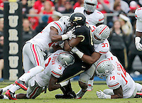 Purdue Boilermakers tight end Sterling Carter (81) gets surrounded by Buckeyes during the second half of the NCAA football game at Ross-Ade Stadium in West Lafayette, IN on Saturday, November 2, 2013. (Columbus Dispatch photo by Jonathan Quilter)