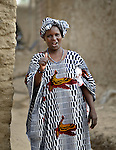 A woman in Timbuktu, the northern Mali city that was seized by Islamist fighters in 2012 and then liberated by French and Malian soldiers in early 2013. During the jihadis' rule, girls and women could not appear in public unless they were completely covered.
