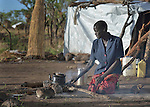 Mary Yandit makes tea in a camp for displaced people in Melijo, South Sudan, near that country's border with Uganda. Families here fled fighting around Bor, in Jonglei State, in December 2013, but have not been warmly welcomed to this region of Eastern Equatoria State, where two earlier waves of displaced people in the 1980s and 1990s have left relations tense between the newcomers, who are Dinka, and the largely Ma'adi residents around the city of Nimule. The ACT Alliance is helping the displaced families and the host communities affected by their presence, and is supporting efforts to reconcile the two groups.