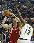 Houston Rockets'  Yao Ming of China (L)  gets fouled by Seattle SuperSonics' Jerome James (R) during the first period of their game at Key Arena in Seattle, Washington Monday, 11 April 2005. .Jim Bryant Photo. &copy;2010. All Rights Reserved.