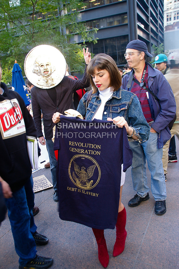 "Protester holds ""Revolution Generation... Debt Is Slavery"" t-shirt at the Occupy Wall Street Protest in New York City October 6, 2011."