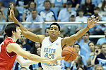 21 December 2013: North Carolina's James Michael McAdoo (43) guards Davidson's Jake Belford (left). The University of North Carolina Tar Heels played the Davidson College Wildcats at the Dean E. Smith Center in Chapel Hill, North Carolina in a 2013-14 NCAA Division I Men's Basketball game. UNC won the game 97-85 in overtime.