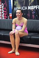 """Silviya Miteva of Bulgaria smiles from """"kiss & cry""""  during event finals at 2010 Grand Prix Marbella at San Pedro Alcantara, Spain on May 16, 2010.  Silviya placed 9th AA at Marbella. (Photo by Tom Theobald)."""