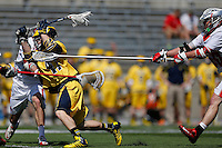 Michigan's Kyle Jackson (47) scores a goal under heavy defense from the Ohio State Buckeyes in the second quarter of the NCAA lacrosse game between the Ohio State Buckeyes and Michigan Wolverines at Ohio Stadium in Columbus, Saturday morning, April 12, 2014. The Ohio State Buckeyes defeated the Michigan Wolverines 15 - 6. (The Columbus Dispatch / Eamon Queeney)