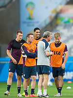 England manager Roy Hodgson at training with Luke Shaw and Chris Smalling who have all been handed starts for the match against Costa Rica, as well as Wayne Rooney and Phil Jones