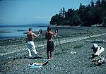 Men painting on beach near Eastsound on Orcas Island