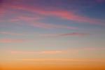 Multi-colored cirrus clouds at sunset in Malibu, California, USA
