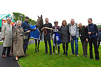 Connections of Intimately celebrate in the winners enclosure during Afternoon Racing at Salisbury Racecourse on 18th May 2017