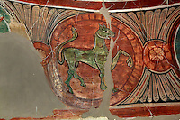 Detail of mural paintings depicting a mythical animal in the apse of Santa Maria de Taull Church, 1123, consecrated by Ramon Guillem, the bishop of Roda, Taull, Province of Lleida, Catalonia, Spain. The church was heavily renovated in the 18th century. Its frescoes were removed to the MNAC (National Art Museum of Catalonia, Barcelona) circa 1918. Santa Maria de Taull Church is part of the Catalan Romanesque churches of the Vall de Boí which were declared a World Heritage Site by UNESCO in November 2000. Picture by Manuel Cohen
