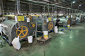 Washing machines in clothing factory, Hanoi, Vietnam
