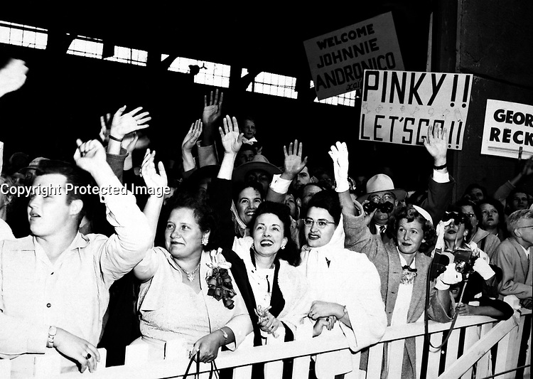 The families of the returning POW's waving and greeting the ship the General Nelson M. Walker as it docks at Fort Mason, California.  August 23, 1953.  Pfc. Brink.  (Army)<br /> NARA FILE #:  111-SC-425769<br /> WAR &amp; CONFLICT BOOK #:  1519