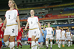 15 August 2008: Heather Mitts (USA) (2), Lindsay Tarpley (USA) (5) and the rest of the USA team comes onto the field, pregame.  The women's Olympic team of the United States defeated the women's Olympic soccer team of Canada 2-1 after extra time at Shanghai Stadium in Shanghai, China in a Quarterfinal match in the Women's Olympic Football competition.