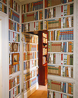 'Bibliotheque' wallpaper by Brunschwig & Fils has been used to striking effect in the corridor of this London house