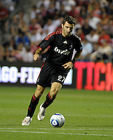 AC Milan midfielder Gennaro Delvechhio (27) dribbles the ball.  AC Milan defeated the Chicago Fire 1-0 at Toyota Park in Bridgeview, IL on May 30, 2010.