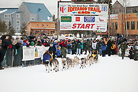 Dog Musher Jeff King leaves the shoot for the 1000 mile 2003 Iditarod sled dog race from Fairbanks to Nome, Alaska . Lack of snow along the normal trail route further south forced the relocation of the restart on the Chena River in Fairbanks.