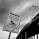 A sign warns of the dangers of attempting to cross the Rio Grande under a bridge that connects Juarez, Chihuahua, Mexico to El Paso, TX, on Monday, Jan. 28, 2008.