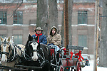 TORRINGTON, CT - 2 January, 2009 - 010209MO01 -  Ken Wood, left, owner of Wood Acres Farm in Terryville, and his son, Dan, gave rides in this carraige pulled by an American Cream and English Shire (right) during Torrington's Last Night celebration held Friday due to inclement weather on New Year's Eve. Jim Moore Republican-American.