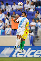 Carlos Ruiz (20) of Guatemala heads the ball during a CONCACAF Gold Cup group stage match at Red Bull Arena in Harrison, NJ, on June 13, 2011.