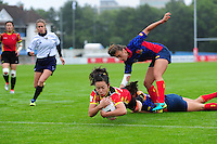 Xu Yang of PR China scores a try. FISU World University Championship Rugby Sevens Women's 7th/8th place match between Spain and PR China on July 9, 2016 at the Swansea University International Sports Village in Swansea, Wales. Photo by: Patrick Khachfe / Onside Images