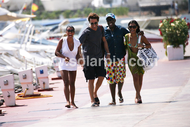 **ALL ROUND PICTURES FROM SOLARPIX.COM**.**WORLDWIDE SYNDICATION RIGHTS**.Jaciara de Sousa (white dress) who is the second wife of Chelsea's new Portuguese signing Deco, on holiday in Ibiza. They are now in the process of a divorce..JOB REF:  6920    AB1        DATE:  28.07.08.**MUST CREDIT SOLARPIX.COM OR DOUBLE FEE WILL BE CHARGED* *UNDER NO CIRCUMSTANCES IS THIS IMAGE TO BE REPRODUCED FOR ANY ONLINE EDITION WITHOUT PRIOR PERMISSION*