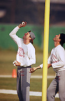 San Francisco 49ers quarterback Joe Montana, left, Steve Rene, attempt to throw rolls of paper into the top of a goal post before practice at the 49ers training facility in Santa Clara, California, Thursday, Jan. 11, 1991. At practice time, Montana was the only QB to successfully complete the task. The 49ers are preparing to face the Washington Redskins in Saturday?s playoff game. (photo by Alan Greth)