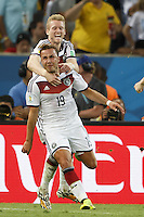 Mario Gotze of Germany celebrates scoring a goal with Andre Schurrle after making it 1-0