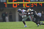 Ole Miss' Jeff Scott (3) is tackled by Vanderbilt linebacker Archibald Barnes (15) in Nashville, Tenn. on Saturday, September 17, 2011. Vanderbilt won 30-7..
